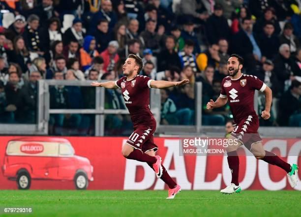 Torino's Serbian forward Adem Ljajic celebrates after scoring during the Italian Serie A football match Juventus vs Torino FC at the Juventus stadium...