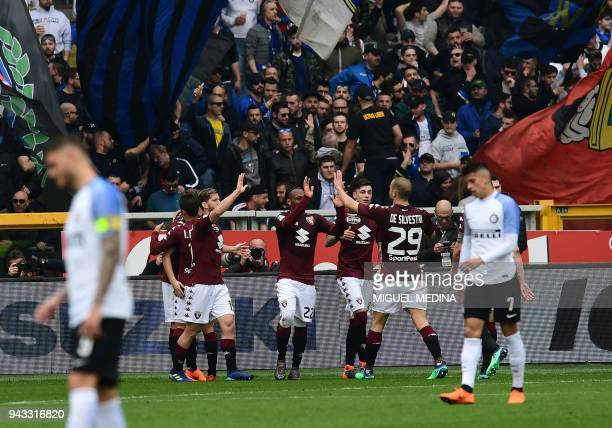Torino's Serbian forward Adem Ljajic celebrates with teammates after scoring during the Italian Serie A football match Torino FC vs Inter Milan at...