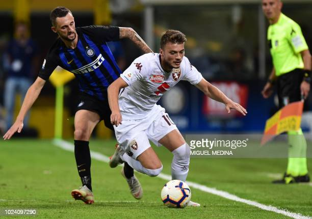 Torino's Serbian forward Adem Ljajic outruns Inter Milan's Croatian midfielder Marcelo Brozovic during the Italian Serie A football match Inter Milan...