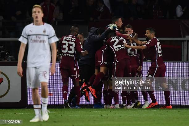 Torino's Spanish forward Alejandro Berenguer celebrates with his teammates after scoring a goal during the Italian Serie A football match between...