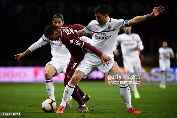 Torino's Spanish forward Alejandro Berenguer vies for the ball with AC Milan's defender Alessio Romagnoli during the Italian Serie A football match...