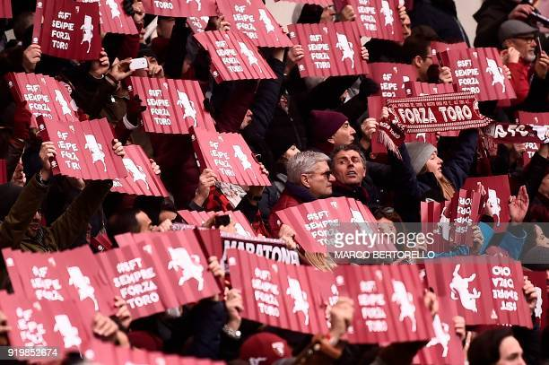 Torino's supporters hold banner during the Italian Serie A football match Torino Vs Juventus on February 18, 2018 at the 'Stadio Grande Torino' in...