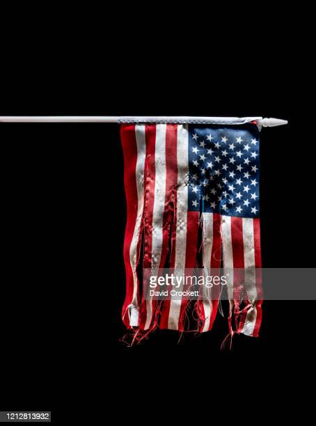torn american flag - torn stock pictures, royalty-free photos & images