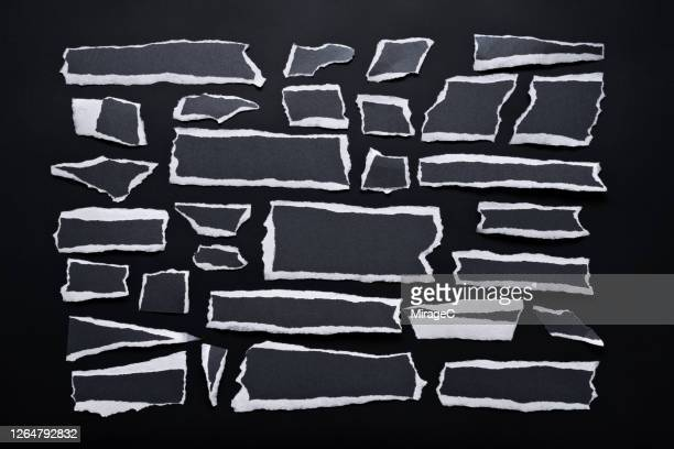 torn black paper pieces with white edge - torn stock pictures, royalty-free photos & images