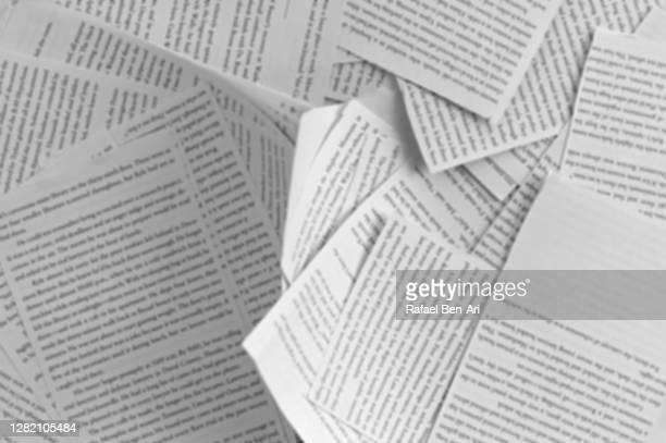 torn book pages background - rafael ben ari foto e immagini stock