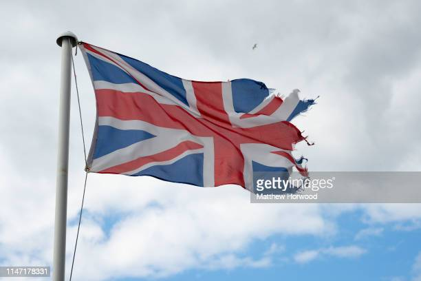Torn British Union Jack flying in the wind on May 5, 2019 in Cardiff, United Kingdom.