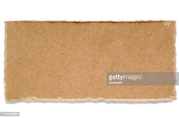 Torn cardboard paper on white