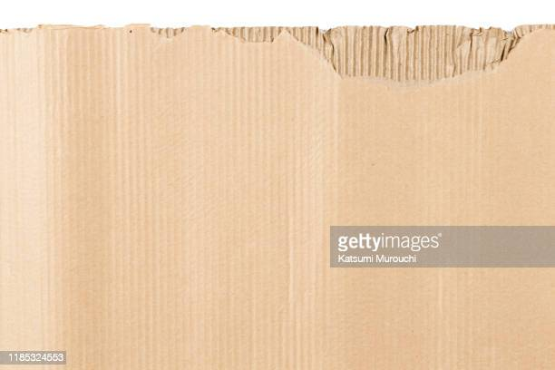 torn cardboard texture background - cardboard stock pictures, royalty-free photos & images
