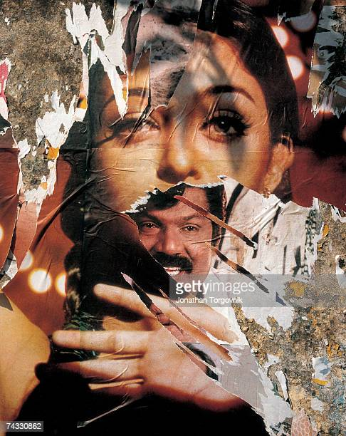 Torn cinema posters on a wall January 1997 in Chennai India Cinema banners and printed posters are placed on almost every bare wall turning the...