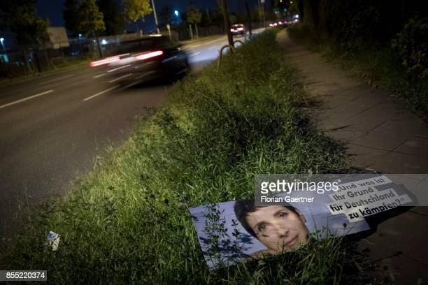 A torn election poster of Frauke Petry former leader of the rightwing party Alternative fuer Deutschland is placed at the roadside on September 28...