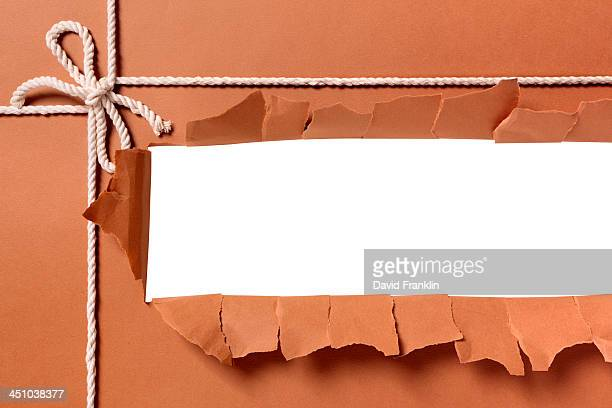 Torn package with white string or rope