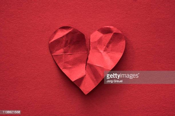 torn paper heart - broken heart stock pictures, royalty-free photos & images