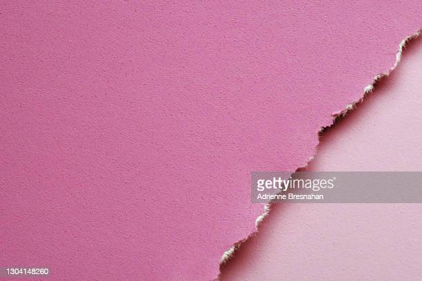 torn paper in tonal shades of pink - torn stock pictures, royalty-free photos & images