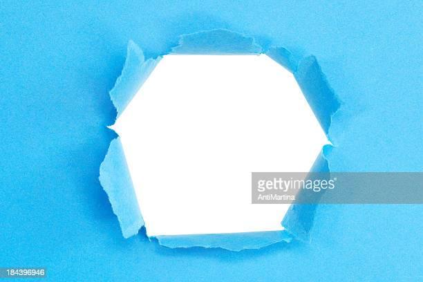 Zerrissenes Papier mit dem Loch