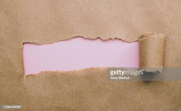 torn paper with space for text, craft brown paper with pink background - torn stock pictures, royalty-free photos & images