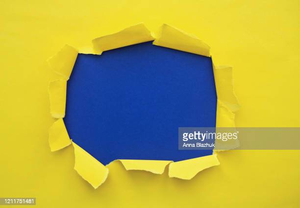 torn paper with space for text with blue background - deterioration stock pictures, royalty-free photos & images