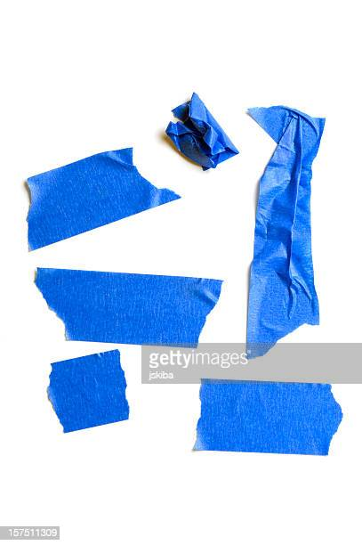 torn peices of grunge blue painter's tape - adhesive tape stock pictures, royalty-free photos & images