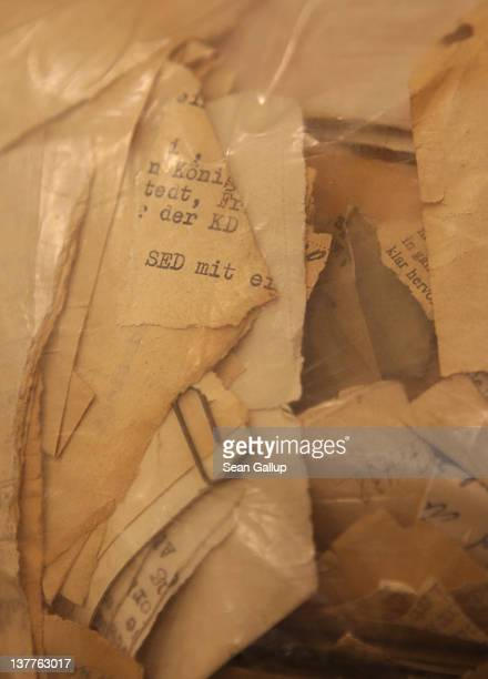 A torn piece of paper with the initials SED short for the Sozialistische Einheitspartei Deutschlands or Socialist Unity Party of Germany which was...