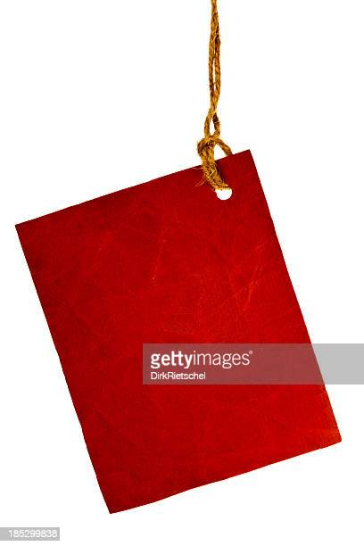 Torn piece of red paper.