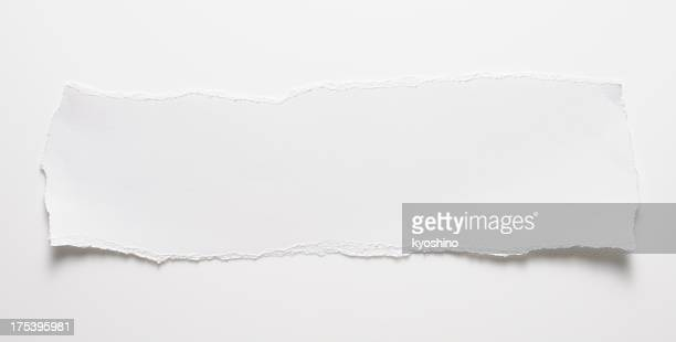 Torn piece of white paper on white background