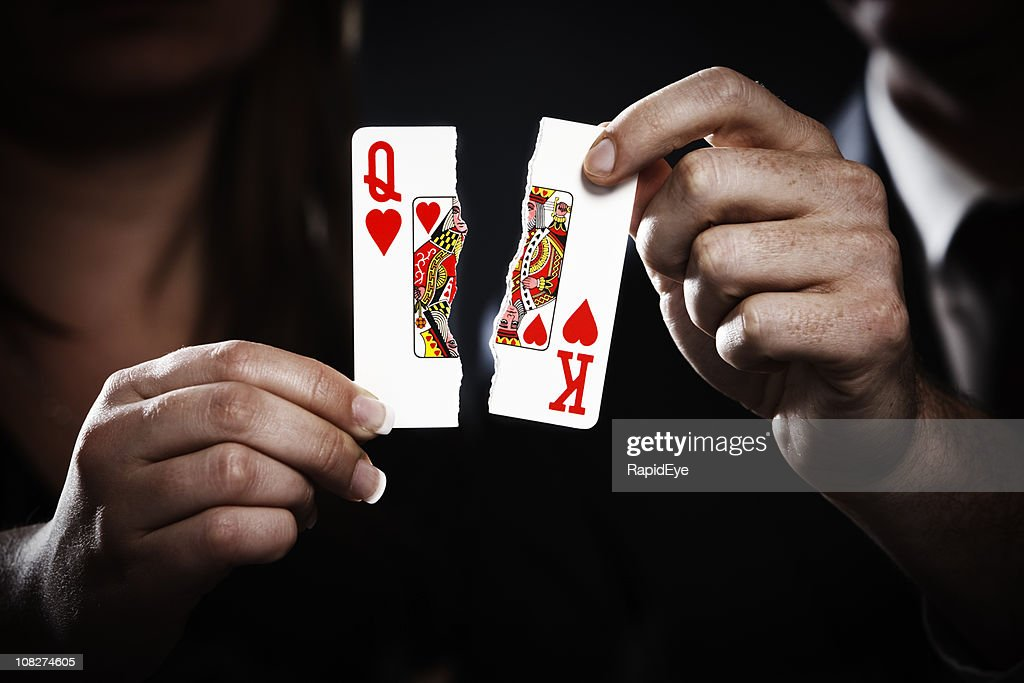 Torn playing cards symbolize divorce : Stock Photo