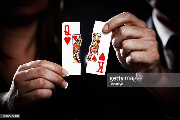 Torn playing cards symbolize divorce