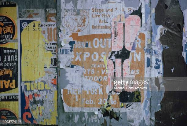 Torn poster for the National Outdoor Exposition on a wall in Manhattan, New York City, August 1962.