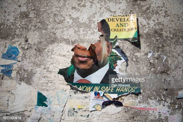 A torn poster of President Elect Emmerson Mnangagwa on August 05 2018 in Harare Zimbabwe Zimbabwe Electoral Commission officials have announced the...