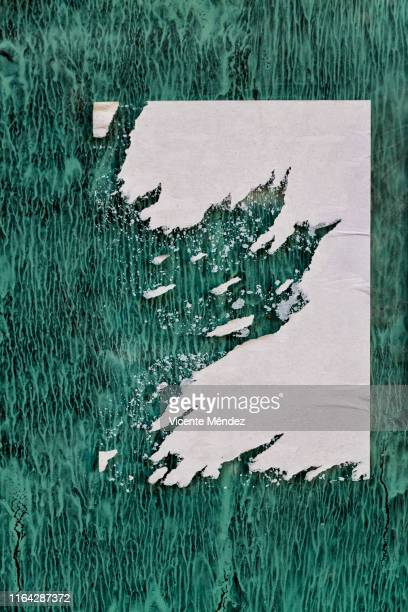 torn poster on painted glass - poster stock pictures, royalty-free photos & images