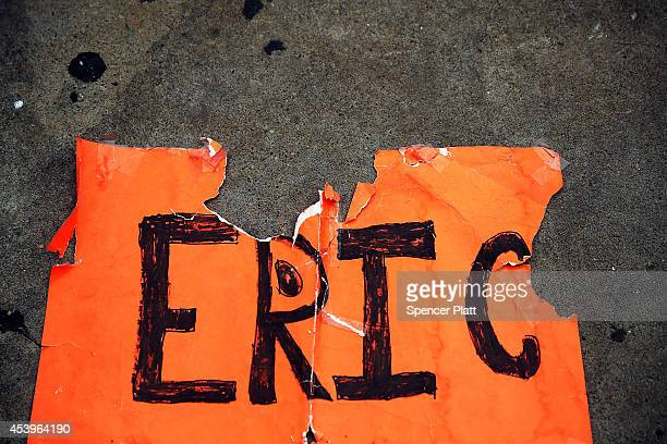A torn poster with the name Eric on it is seen near where Eric Garner was killed in an encounter with an NYPD officer in July on August 22 2014 in...