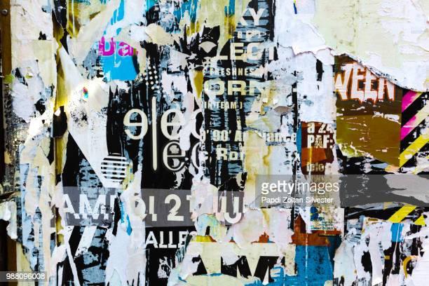 torn posters - vandalismus stock-fotos und bilder
