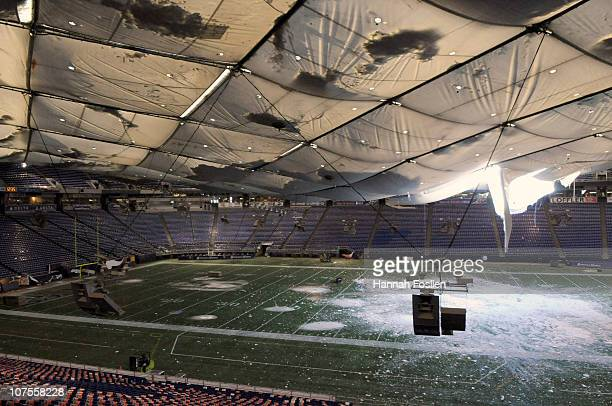 A torn section of the roof sags inside the Hubert H Humphrey Metrodome on December 13 2010 in Minneapolis Minnesota The Metrodome's roof collapsed...