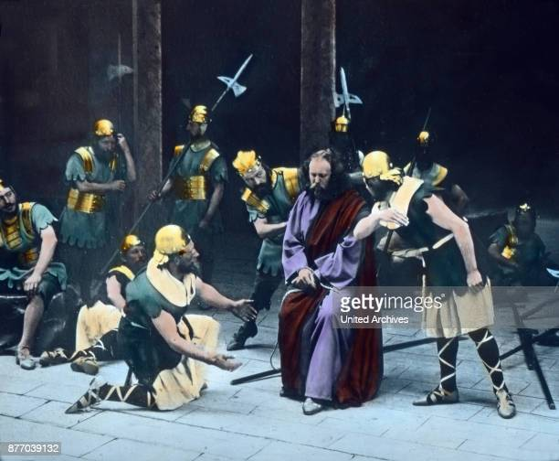 Torn up by the brutality of the soldiers he is mocking way abused a second time as king whereby he has a torn purple robe and a scepter tube is...