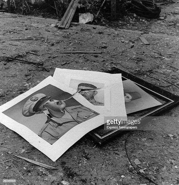 Torn up photographs of the Egyptian President Colonel Nasser during the Suez Crisis