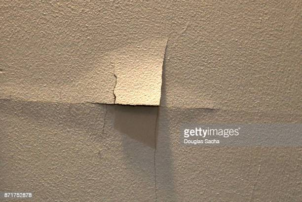torn wallpaper on an interior wall - ugly wallpaper stock photos and pictures