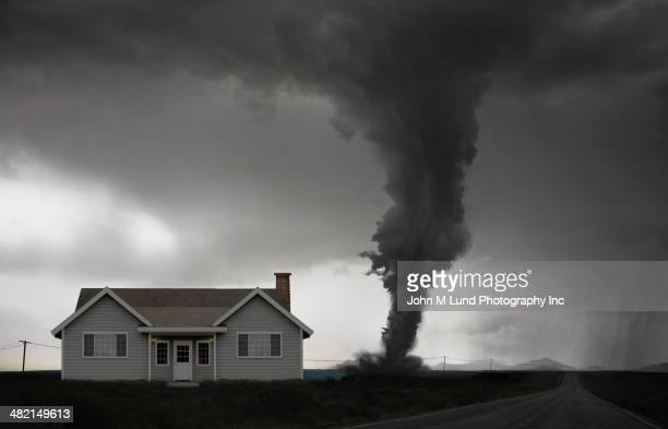 tornado approaching house in rural landscape - john lund stock pictures, royalty-free photos & images