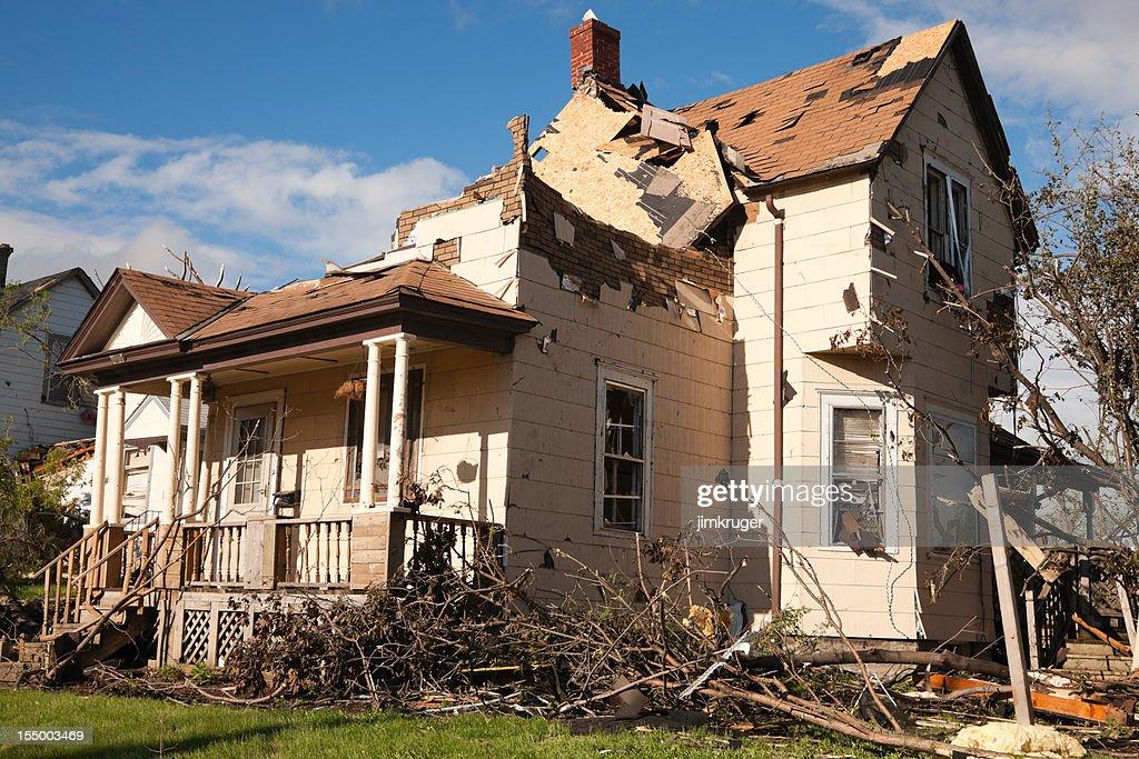 Tornado battered home severely damaged. : Stock Photo