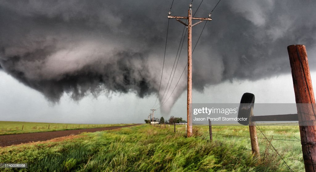 Tornado behind  farmhouse with angry, violent rotating wall cloud, Stratton, Colorado, USA : Stock Photo