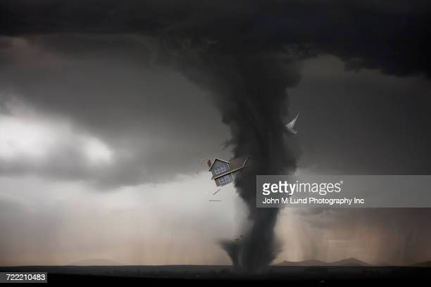 tornado carrying house - tornado stock pictures, royalty-free photos & images