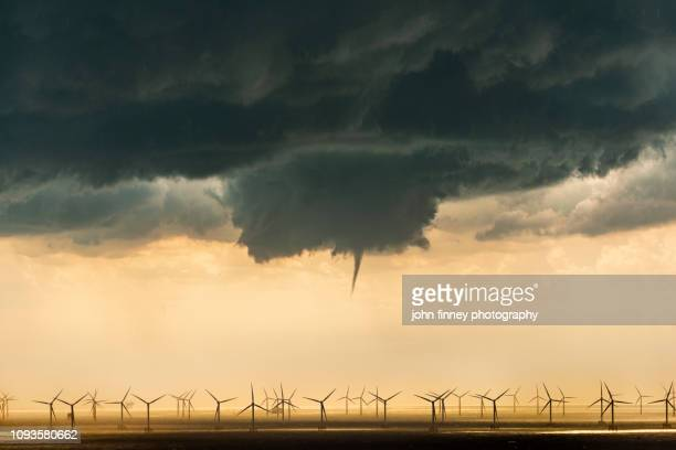 a tornado funnel cloud over a wind farm. uk. - meteo estremo foto e immagini stock
