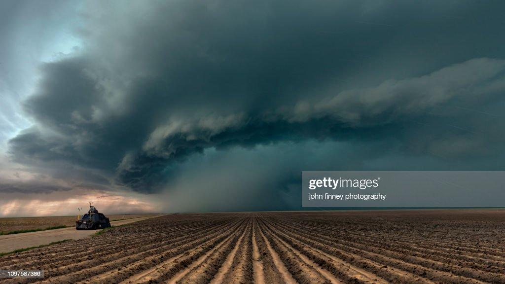 Tornado Intercept Vehicle with a severe thunderstorm, Colorado. USA : Stock Photo