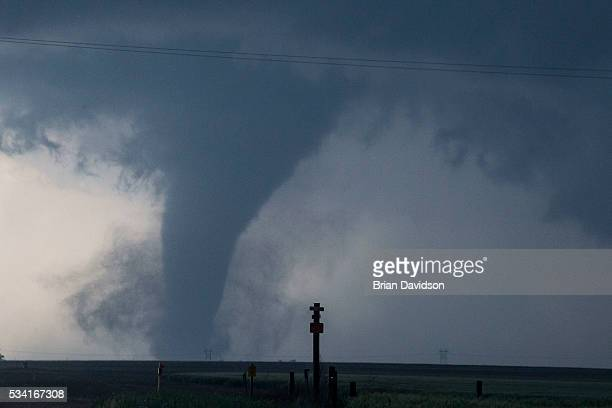A tornado is seen South of Dodge City Kansas moving North on May 24 2016 in Dodge City Kansas About 30 tornadoes were reported on Tuesday in five...