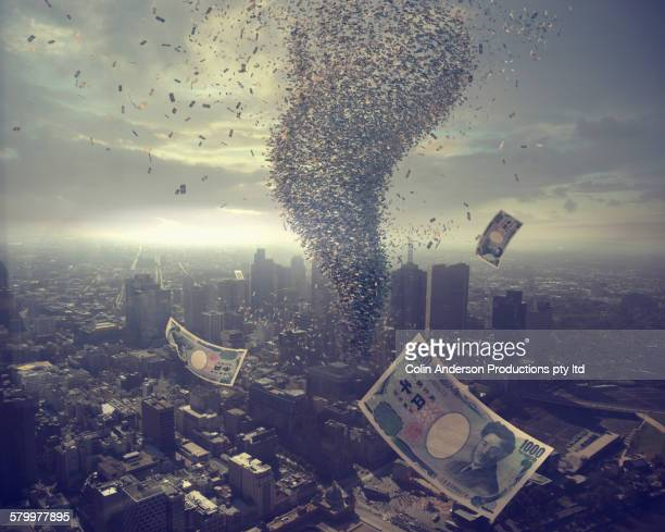 tornado of money over cityscape - japanese yen note stock photos and pictures