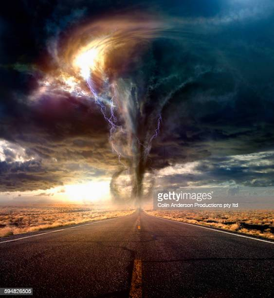 tornado on remote desert road - tornado stock pictures, royalty-free photos & images