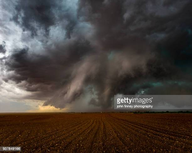 tornado over farmland near patricia, texas - storm cloud stock pictures, royalty-free photos & images