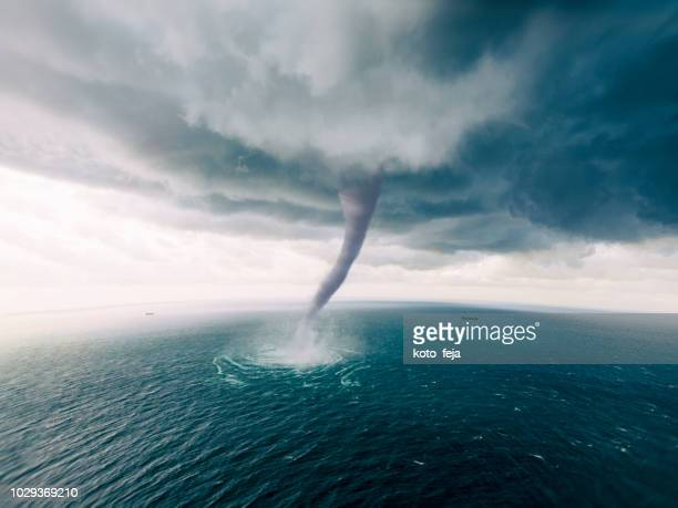 tornado sea - hurricane storm stock pictures, royalty-free photos & images