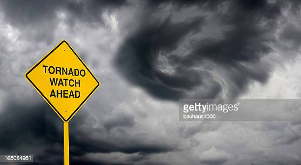 tornado watch road sign - warning sign stock pictures, royalty-free photos & images