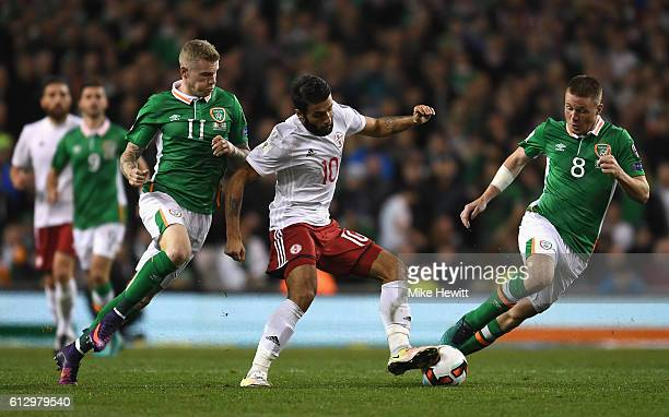 Tornike Okriashvili of Georgia is closed down by James McClean of Republic of Ireland and James McCarthy of Republic of Ireland during the FIFA 2018...