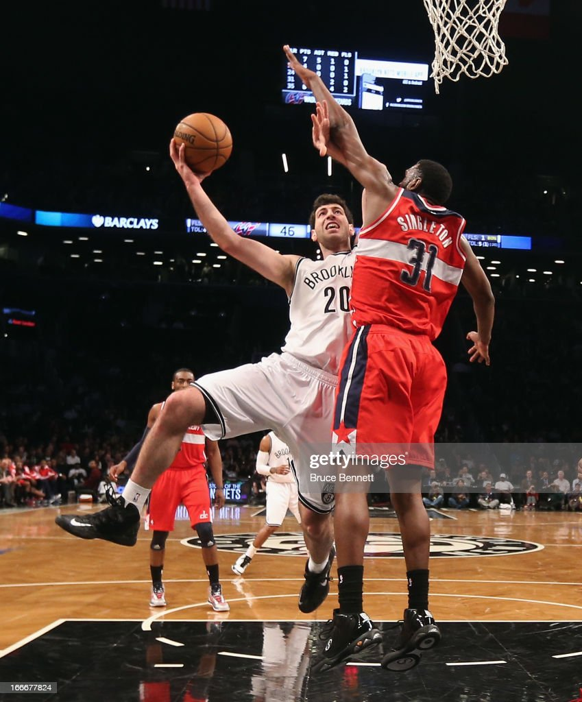 Tornike Shengelia #20 of the Brooklyn Nets goes up and scores two against the Washington Wizards at the Barclays Center on April 15, 2013 in New York City. The Nets defeated the Washington Wizards 106-101.