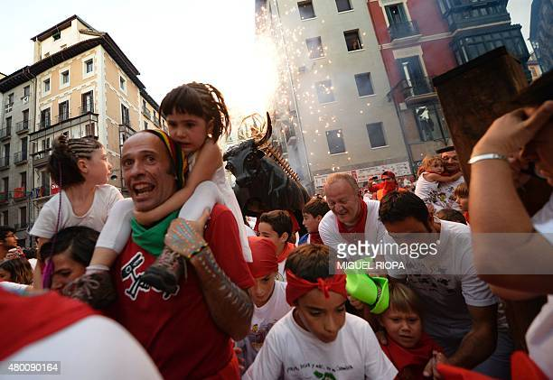 A 'Toro de Fuego' chases people during the San Fermin Festival on July 9 in Pamplona northern Spain The festival is a symbol of Spanish culture that...